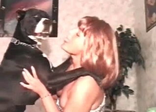 Redhead makes out with her own dog